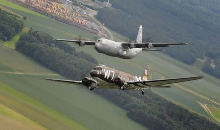 Handout photo of former U.S. Air Force C-47 Skytrain aircraft flying alongside a C-130J Super Hercules aircraft over Germany