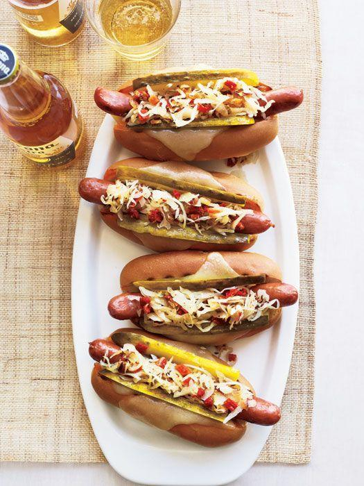 """<p>Go ahead and pile on the toppings with these New-York-deli-inspired hot dogs. Or swap corned beef for wieners for a completely fresh take. </p><p><em><a href=""""https://www.goodhousekeeping.com/food-recipes/a11012/grilled-reuben-dogs-recipe-rbk0611/"""" rel=""""nofollow noopener"""" target=""""_blank"""" data-ylk=""""slk:Get the recipe for Grilled Reuben Dogs »"""" class=""""link rapid-noclick-resp"""">Get the recipe for Grilled Reuben Dogs »</a></em> </p>"""