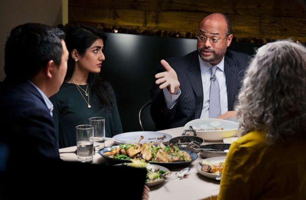 PHOTO: Democratic presidential candidate Andrew Yang, left, listens to Ramsey Smith, right, during a dinner with Jaslin Kaur and Mara Novak, in New York, Dec. 4, 2019. (Arturo Holmes/ABC)
