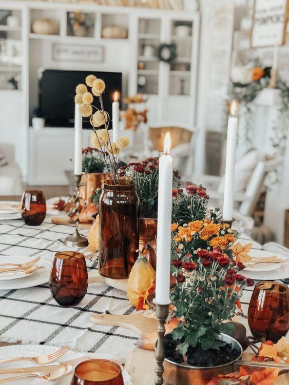 """<p>For a more traditional tablesetting, keep the linens and place settings minimal and add accents of red and amber. It's a fall color palette, yes, but with more sophistication.</p><p><a class=""""link rapid-noclick-resp"""" href=""""https://www.uniquelytaylormade.com/all-thrifted-fall-tablescape/"""" rel=""""nofollow noopener"""" target=""""_blank"""" data-ylk=""""slk:See more at Uniquely Taylor Made"""">See more at Uniquely Taylor Made</a></p>"""