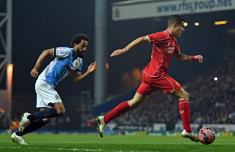 Liverpool's Brazilian midfielder Philippe Coutinho (R) runs in to score a goal during the English FA Cup quarter-final replay football match between Blackburn Rovers and Liverpool in Blackburn, England on April 8, 2015 (AFP Photo/Paul Ellis)