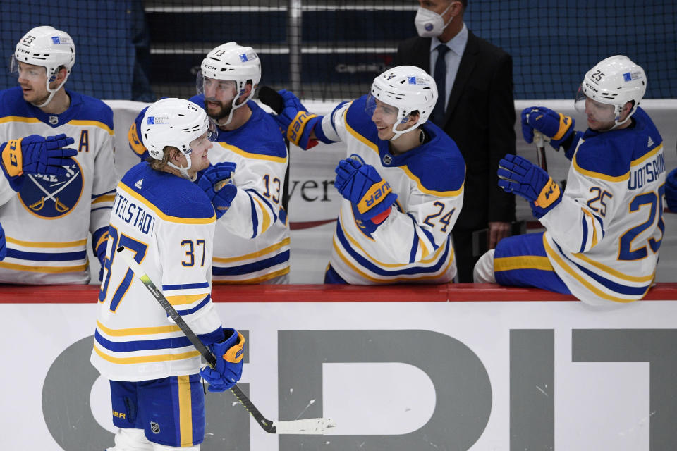 Buffalo Sabres center Casey Mittelstadt (37) is congratulated on his goal during the second period of the team's NHL hockey game against the Washington Capitals, Thursday, April 15, 2021, in Washington. (AP Photo/Nick Wass)
