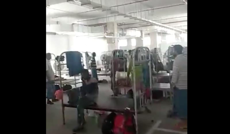 Foreign workers being housed in multi-storey car parks in Singapore. (PHOTO: Screengrab from video/Facebook)