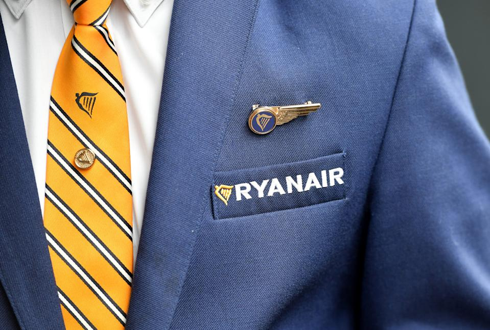 A Ryanair cabin crew member and union representative arrives ahead of a press conference held by Ryanair unions representatives, in Brussels, on September 13, 2018. - Ryanair cabin crew members from five European countries will go on strike on September 28, a Belgian union said on September 13, 2018. Staff from Belgium, the Netherlands, Italy, Spain and Portugal will stage a stoppage on the Irish no-frills airline, the CNE said, after several European labour unions met in Brussels. (Photo by Emmanuel DUNAND / AFP)        (Photo credit should read EMMANUEL DUNAND/AFP via Getty Images)