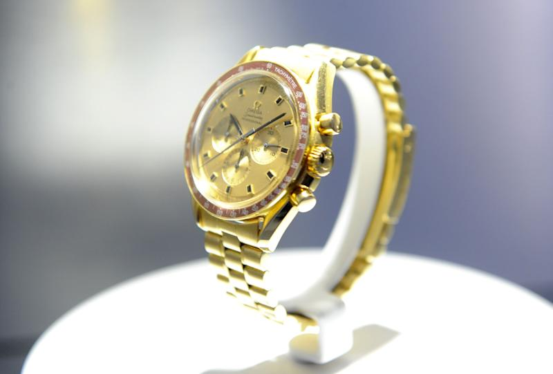 """(Bloomberg Opinion) -- For a watchmaker, Swatch Group AG has pretty terrible timing. The Swiss company said on Wednesday that its sales in the first half of 2019 were held back by cracking down on so-called """"gray market"""" dealers, who sell stock at a discount.Analysts at RBC estimatethat this punitive action cost Swatch """"triple-digit millions"""" in lost sales during the period, contributing to a worse-than-expected 3.7% decline in first-half revenue. Tackling the gray market is the right thing to do because the practice dents a watchmakers' full-price sales and devalues its top-end brands (which in Swatch's case include Omega and Longines). But what took it so long?Its big Swiss rival Cie Financiere Richemont SA, which owns Cartier, has been buying back its stock for the past few years rather than letting dealers sell it for knockdown prices.While it's largely at the end of this process, it still aims to keep supply in line with demand, or ideally below it, to boost desirability.Swatchhas taken a different approach.It is suspending deliveries to dealers rather than buying back inventory. Even so, it is a welcome attempt to clean up the market and should be beneficial in the longer term.The only problem is that the crackdown comes at an already delicate moment for the group. Swatch is heavily exposed to China and Hong Kong, with 22% of its revenue coming from the mainland and 11% from Hong Kong, according to analysts at Bryan Garnier. Yetsales in Hong Kong fell by a double-digit percentagein the first half because of the protests and political turbulence in the city,Swatch said. This echoes Chow Tai Fook Jewellery Group Ltd., whose same-store sales slipped 11% in Kong Kong and Macau in the three months to June 30.With such a big exposureSwatch is clearly at risk from any prolonged problems in Hong Kong, and from any broader Chinese slowdown related to the U.S. price war.At the same time, shoppers are starting to favor Apple-style smartwatches, which is bad news for Swat"""