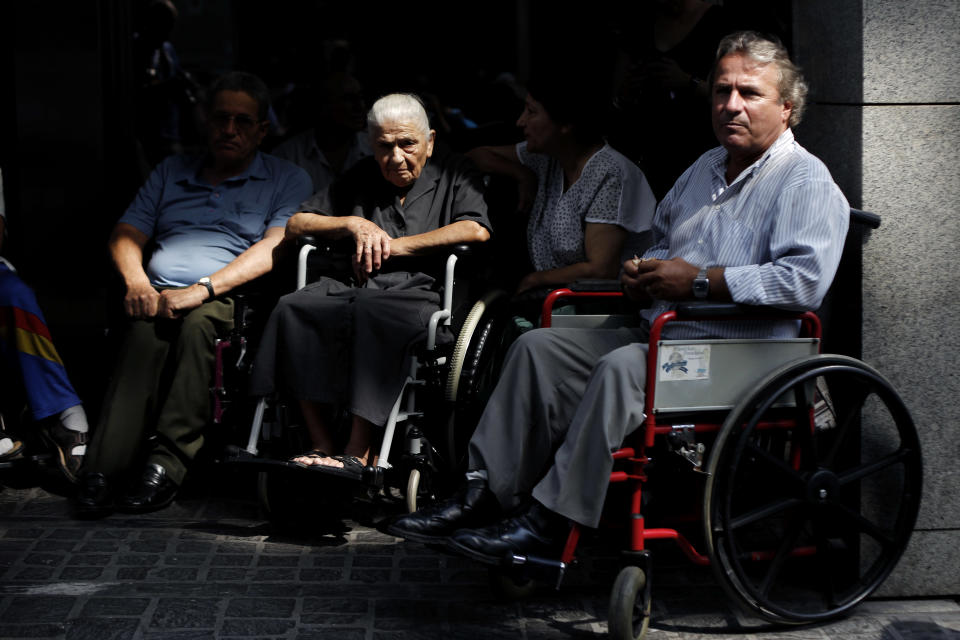 Disabled protesters sit in their wheelchairs during a rally outside the Finance Ministry in Athens, on Thursday, Sept. 13, 2012. Disabled groups are angry at likely benefit cuts under a major new austerity program demanded by international rescue creditors. (AP Photo/Petros Giannakouris)