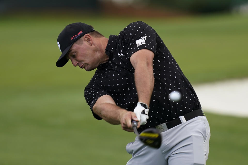 Bryson DeChambeau tees off on the third hole during a practice round for the Masters golf tournament Tuesday, Nov. 10, 2020, in Augusta, Ga. (AP Photo/David J. Phillip)
