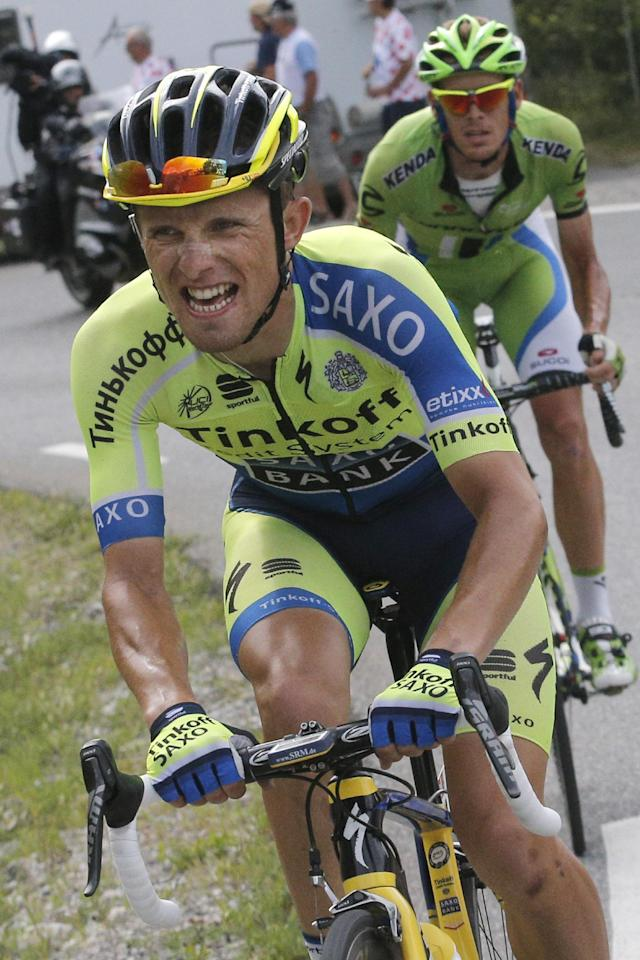 Stage winner Poland's Rafal Majka breaks away from Italy's Alessandro De Marchi as they climb towards Risoul during the fourteenth stage of the Tour de France cycling race over 177 kilometers (110 miles) with start in Grenoble and finish in Risoul, France, Saturday, July 19, 2014. (AP Photo/Christophe Ena)