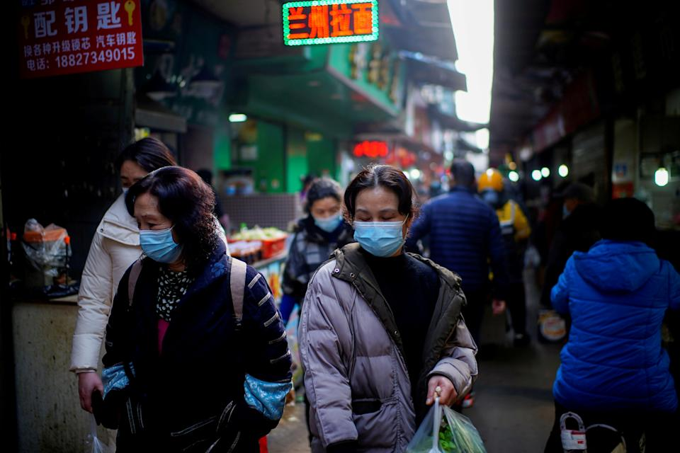 The virus has returned to Wuhan, the city brought to its knees at the start of the pandemic. Source: Reuters