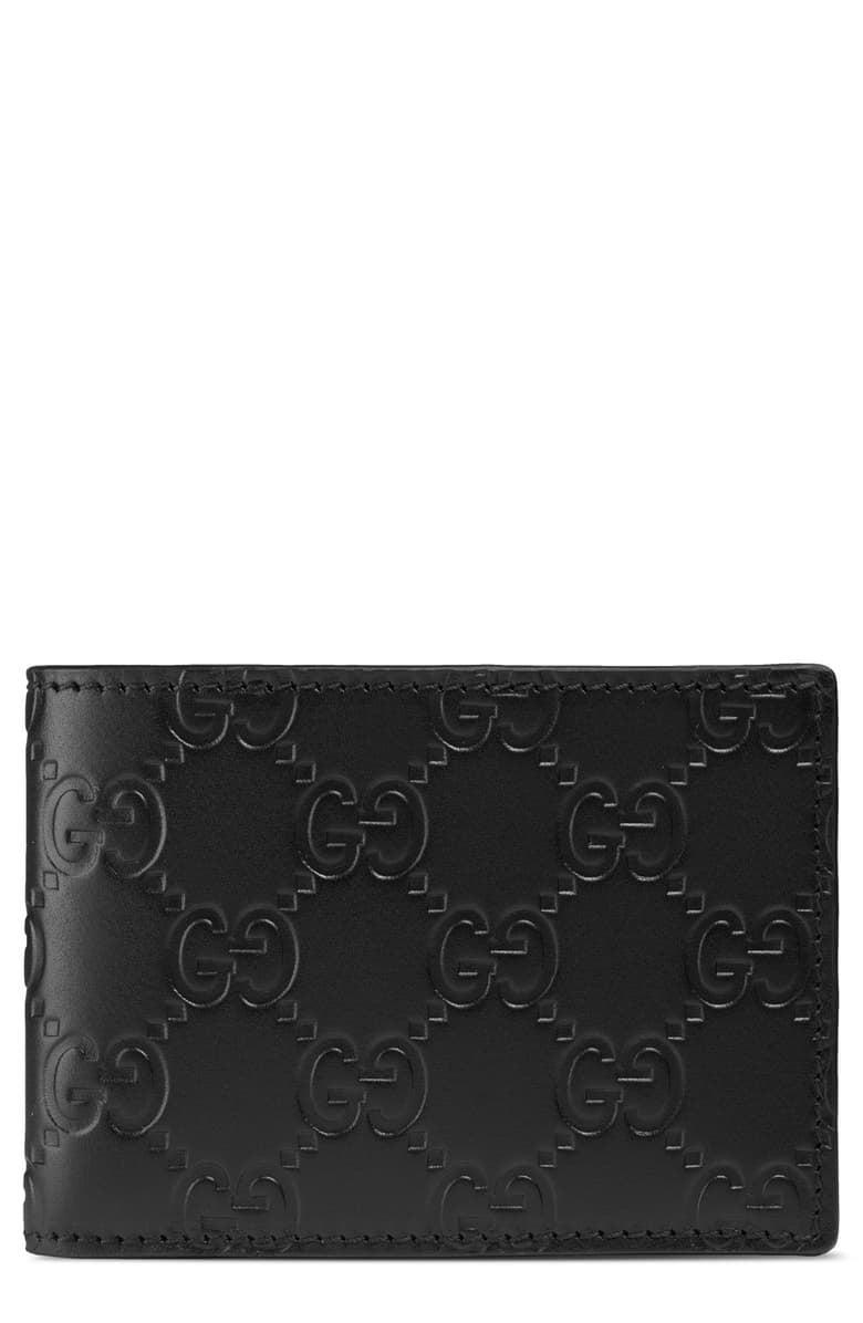<p>Treat him to this timeless <span>Gucci GG Embossed Leather Bi Fold Wallet</span> ($480).</p>