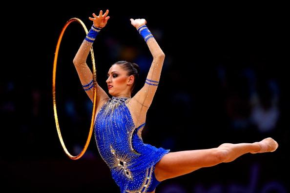 LONDON, ENGLAND - AUGUST 11:  Evgeniya Kanaeva of Russia competes during the Individual All-Around Rhythmic Gymnastics final on Day 15 of the London 2012 Olympics Games at Wembley Arena on August 11, 2012 in London, England.  (Photo by Jamie Squire/Getty Images)