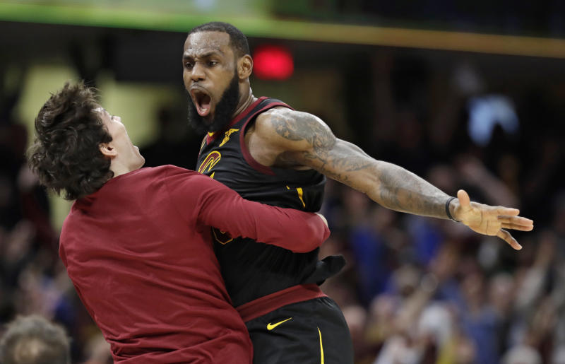 Cleveland Cavaliers' LeBron James, right, celebrates with Cedi Osman, from Turkey, after James shot a game-winning three point shot in the second half of Game 5 of an NBA basketball first-round playoff series, Wednesday, April 25, 2018, in Cleveland. The Cavaliers won 98-95. (AP Photo/Tony Dejak)