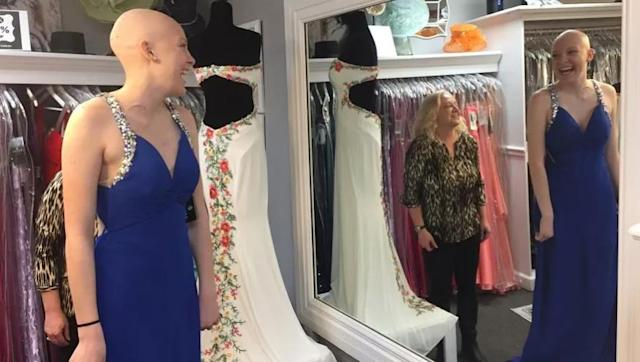 White tries on a prom dress at Lux Boutique. (Photo: Dustin Levy/Evening Sun)