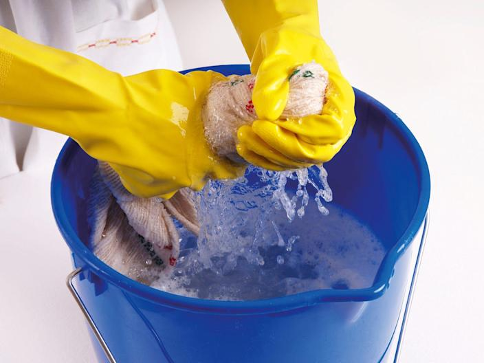 You can mix one cup of bleach with five gallons of water in a bucket to create a solution that will disinfect surfaces.