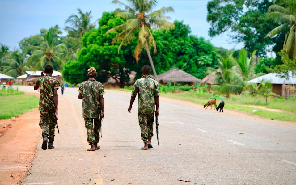Soldiers from the Mozambican army patrol the streets in October 2019 in Mocimboa da Praia, Mozambique. Shadowy islamist militants have launched a sporadic set of attacks on the majority-Muslim province since a first offensive on the town of Mocimboa da Praia in October 2017. - ADRIEN BARBIER /AFP