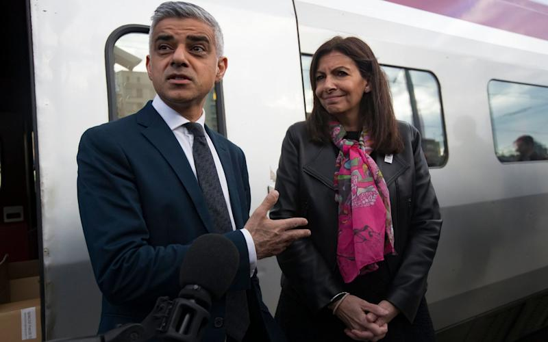The Mayor of London, Sadiq and the Mayor of Paris, Anne Hidalgo talk to the media at Gare du Nord in Paris - EPA