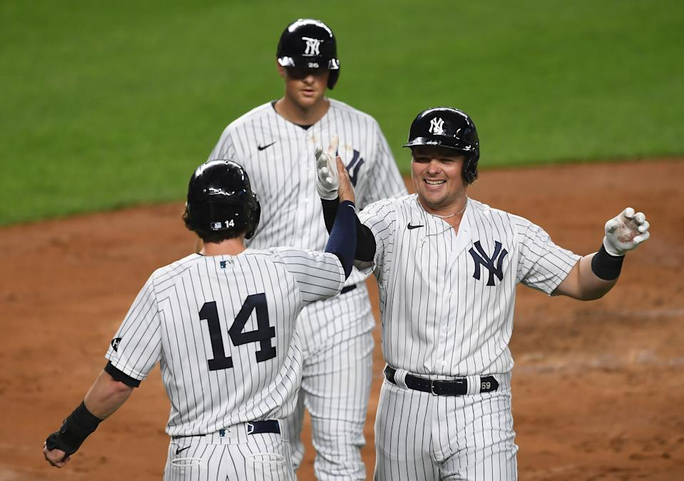 Luke Voit (right) takes over MLB home run lead as Yankees rack up 20 runs against Toronto. (Photo by Sarah Stier/Getty Images)