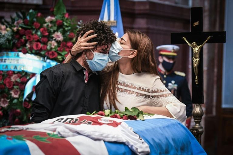 Zulema Menem (R) kisses her half-brother Carlos Nair Menem next to the coffin of their father, former Argentine president (1989-1999) Carlos Menem, as he lay in the Congress in Buenos Aires