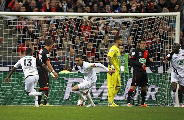 Guingamp player Jonathan Martins Pereira, center, celebrates scoring the first goal for his team during the French Cup final match between Guingamp and Rennes at the Stade de France Stadium, in Saint Denis, North of Paris, Saturday May 3, 2014. (AP Photo/Remy de la Mauviniere)