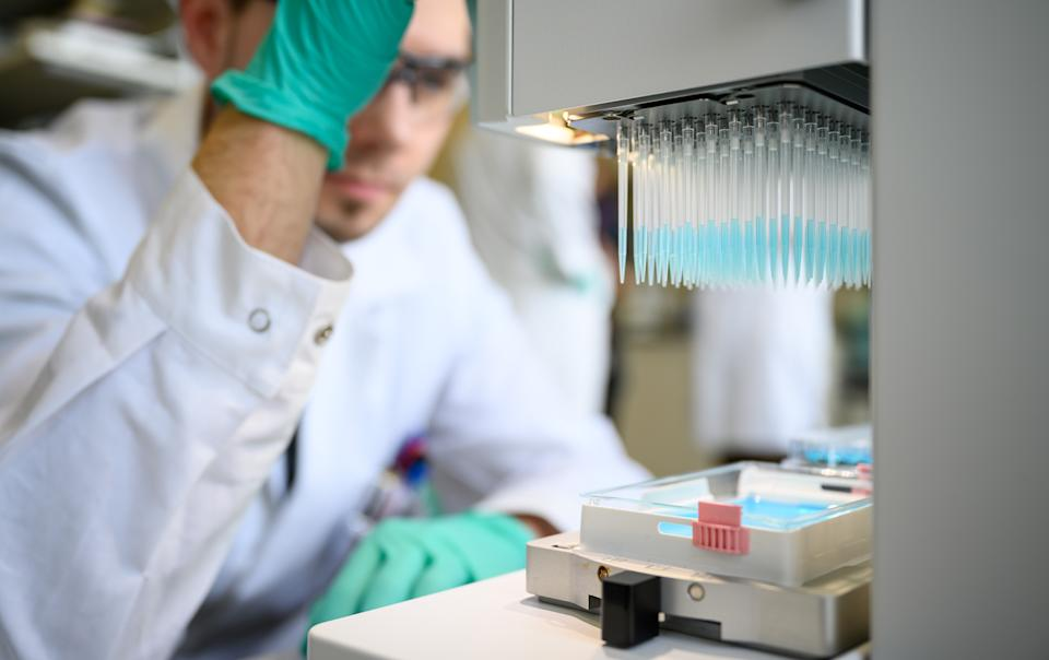 "24 February 2020, Baden-Wuerttemberg, Tübingen: A man pipettes a blue liquid in a laboratory of the biopharmaceutical company Curevac. (to dpa: ""Tübingen company tinkering with the enemy's profile"") Photo: Sebastian Gollnow/dpa (Photo by Sebastian Gollnow/picture alliance via Getty Images)"
