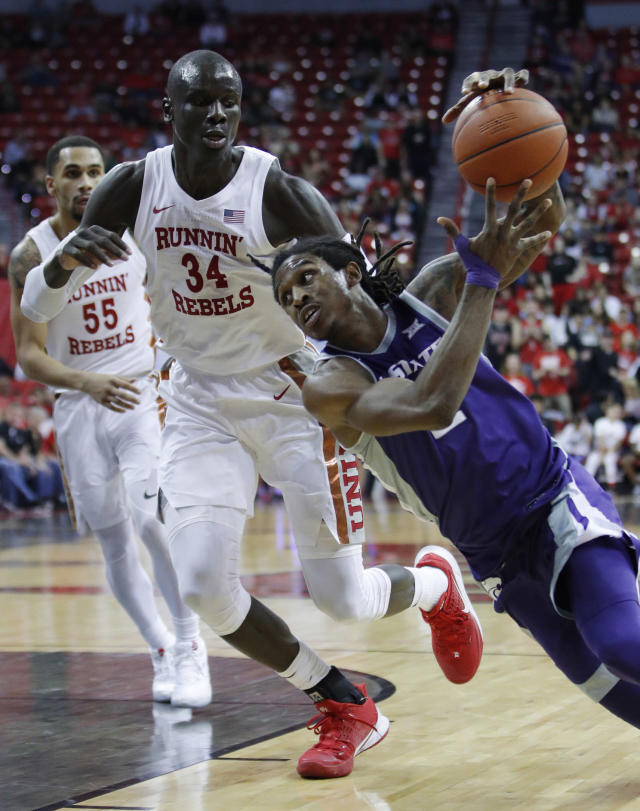 Kansas State's Cartier Diarra, right, drives around UNLV's Cheikh Mbacke Diong during the second half of an NCAA college basketball game Saturday, Nov. 9, 2019, in Las Vegas. (AP Photo/John Locher)