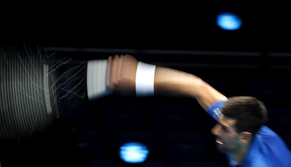 Novak Djokovic of Serbia plays a return to Diego Schwartzman of Argentina during their singles tennis match at the ATP World Finals tennis tournament at the O2 arena in London, Monday, Nov. 16, 2020. (AP Photo/Frank Augstein)