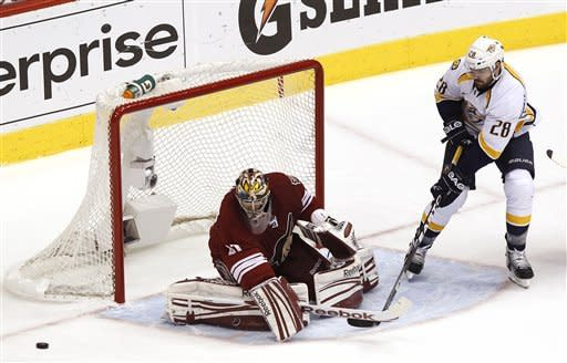 Nashville Predators' Paul Gaustad (28) has his shot blocked by Phoenix Coyotes' Mike Smith in the first period during Game 5 in an NHL hockey Stanley Cup Western Conference semifinal playoff series Monday, May 7, 2012, in Glendale, Ariz. (AP Photo/Ross D. Franklin)