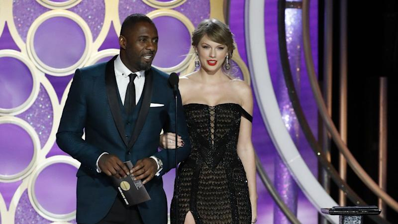 The singer stepped onstage with Idris Elba to present the musical categories at Sunday's ceremony.