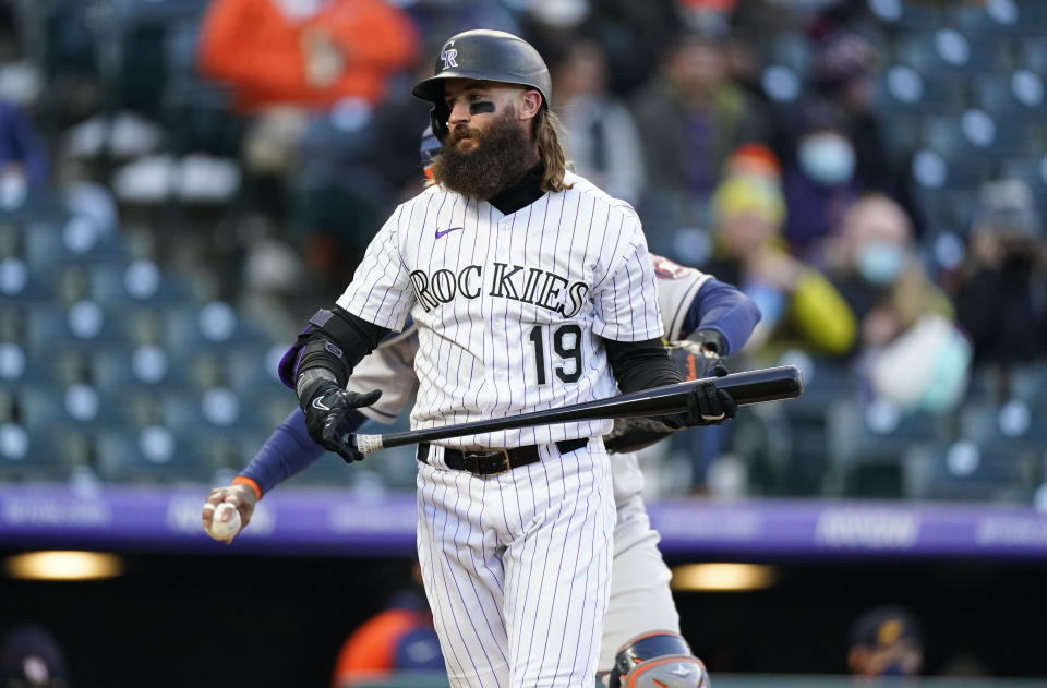 Colorado Rockies' Charlie Blackmon heads back to the dugout after striking out against Houston Astros starting pitcher Luis Garcia during the second inning of a baseball game Tuesday, April 20, 2021, in Denver. (AP Photo/David Zalubowski)