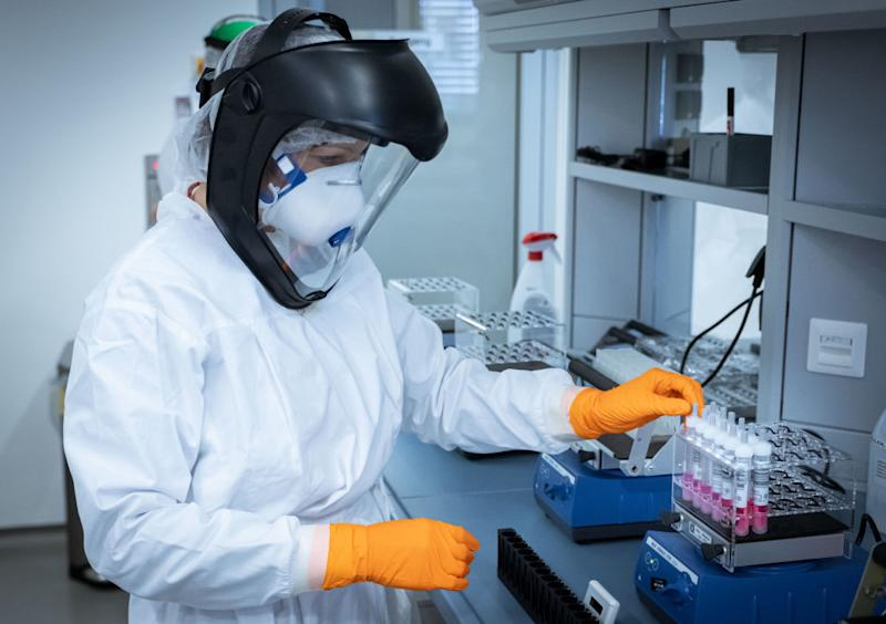 A research assistant in Hanover prepares coronavirus test samples. Source: Getty