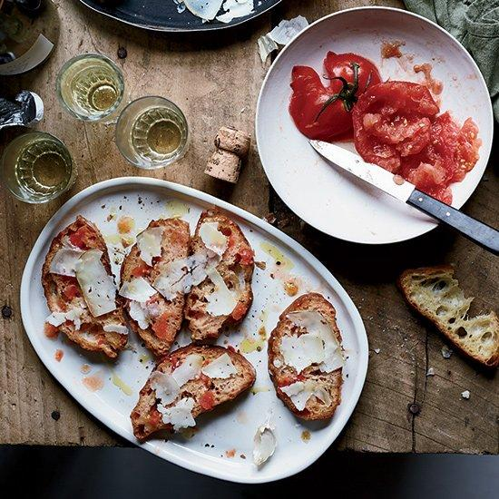 "<p>Garrotxa is a semi-firm Catalan goat cheese that's delicately flavored and perfect for grating over crunchy, garlicky, tomato-rubbed toast.</p><p><a href=""https://www.foodandwine.com/recipes/pan-con-tomate-garrotxa-cheese"">GO TO RECIPE</a></p>"