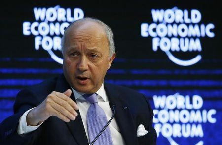 """French Foreign Minister Fabius attends the session """"The New Climate and Development Imperative"""" during the Annual Meeting of the WEF in Davos"""