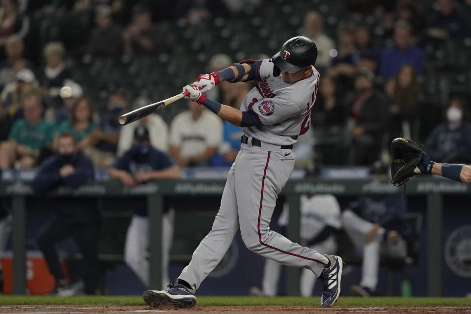 Minnesota Twins' Trevor Larnach hits an RBI-single to score Jorge Polanco during the first inning of a baseball game against the Seattle Mariners, Monday, June 14, 2021, in Seattle. (AP Photo/Ted S. Warren)