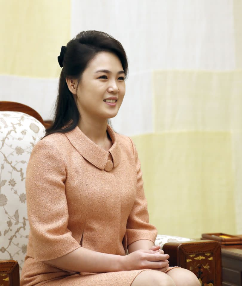 Pictured is Ri Sol-ju smiling while sitting on a chair.