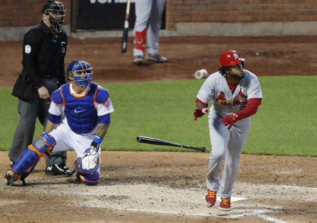 St. Louis Cardinals' Jose Martinez drops his bat after hitting a three-run home run, near home plate umpire Jeff Kellogg and New York Mets catcher Wilson Ramos during the fifth inning of a baseball game Friday, June 14, 2019, in New York. (AP Photo/Kathy Willens)