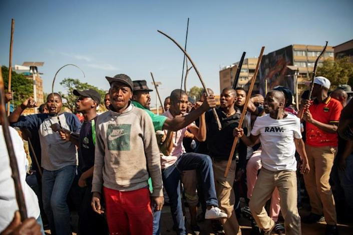 Zulu residents of the Jeppe Men Hostel in Johannesburg took to the streets of the city's business district in Tuesday's disturbances (AFP Photo/Michele Spatari)