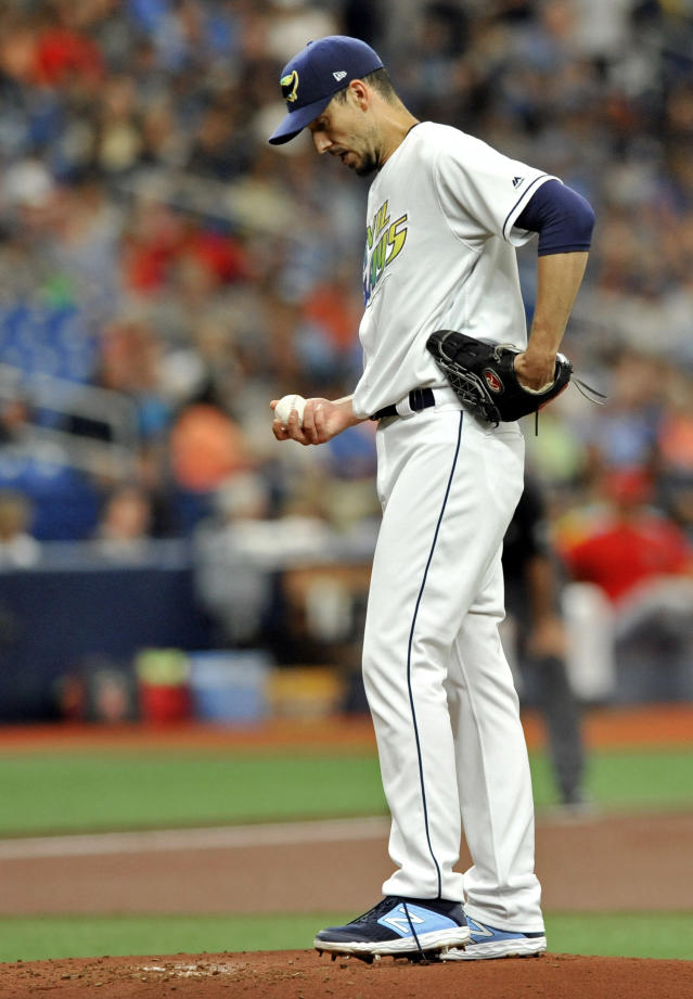 Tampa Bay Rays starter Charlie Morton looks at the ball between pitches against the Los Angeles Angels during the first inning of a baseball game Saturday, June 15, 2019, in St. Petersburg, Fla. (AP Photo/Steve Nesius)