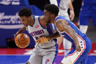Detroit Pistons guard Delon Wright (55) steals the ball away from Philadelphia 76ers guard Shake Milton during the second half of an NBA basketball game, Monday, Jan. 25, 2021, in Detroit. (AP Photo/Carlos Osorio)