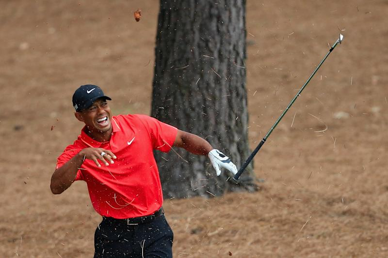 AUGUSTA, GA - APRIL 12: Tiger Woods of the United States reacts to a shot from the pine straw on the ninth hole during the final round of the 2015 Masters Tournament at Augusta National Golf Club on April 12, 2015 in Augusta, Georgia. (Photo by David Cannon/Getty Images)