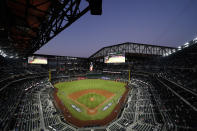Tampa Bay Rays and the Los Angeles Dodgers gather one the field for Game 1 of the baseball World Series Tuesday, Oct. 20, 2020, in Arlington, Texas. (AP Photo/David J. Phillip)