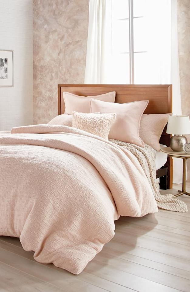 """<p><a href=""""https://www.popsugar.com/buy/DKNY%20Pure%20Texture%20Duvet%20Cover-470386?p_name=DKNY%20Pure%20Texture%20Duvet%20Cover&retailer=shop.nordstrom.com&price=93&evar1=casa%3Aus&evar9=46401102&evar98=https%3A%2F%2Fwww.popsugar.com%2Fhome%2Fphoto-gallery%2F46401102%2Fimage%2F46401134%2FDKNY-Pure-Texture-Duvet-Cover&list1=shopping%2Cnordstrom%2Csales%2Chome%20decor%2Csale%20shopping%2Cnordstrom%20sale%2Chome%20shopping%2Cnordstrom%20anniversary%20sale&prop13=mobile&pdata=1"""" rel=""""nofollow"""" data-shoppable-link=""""1"""" target=""""_blank"""" class=""""ga-track"""" data-ga-category=""""Related"""" data-ga-label=""""https://shop.nordstrom.com/s/dkny-pure-texture-duvet-cover/5125963?origin=category-personalizedsort&amp;breadcrumb=Home%2FAnniversary%20Sale%2FHome&amp;color=blush"""" data-ga-action=""""In-Line Links"""">DKNY Pure Texture Duvet Cover</a> ($93–$113,  originally $140–$170)</p>"""