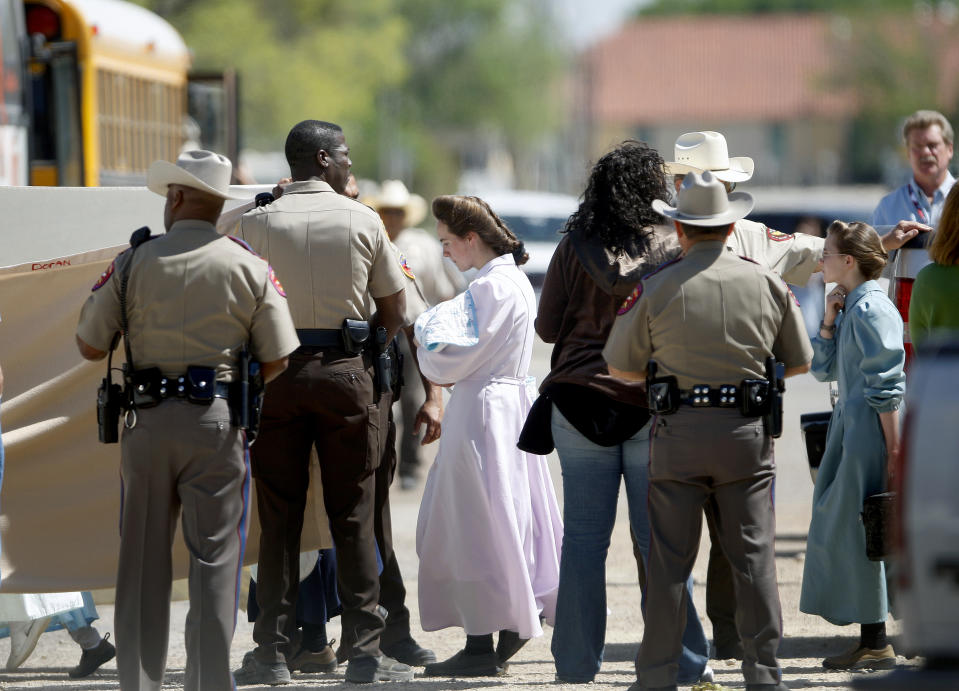 Women and children from the YFZ Ranch, the compound built by polygamist leader Warren Jeffs, are moved by bus to San Angelo, Texas, on Sunday, April 6, 2008. Authorities are investigating allegations of child abuse.  (Photo by Khampha Bouaphanh/Fort Worth Star-Telegram/Tribune News Service via Getty Images)