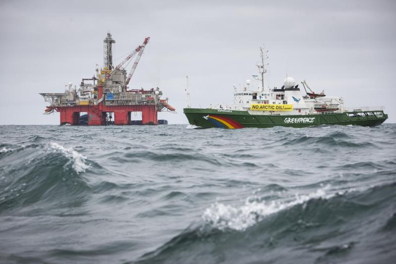 An undated handout photo shows Greenpeace ship Esperanza sailing past Transocean Spitsbergen oil rig on the Norwegian Arctic