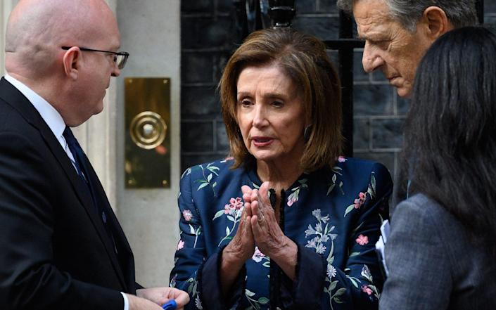 S Ambassador to the UK Philip Reeker (L) speaks with US House Speaker Nancy Pelosi (C) and her husband Paul Pelosi following a meeting with Prime Minister Boris Johnson at Downing Street on September 16, 2021 in London, England. The speaker of the United States House of Representatives is in the UK to participate in the G7 Heads of Parliament Conference this week in Chorley, England - Getty Images