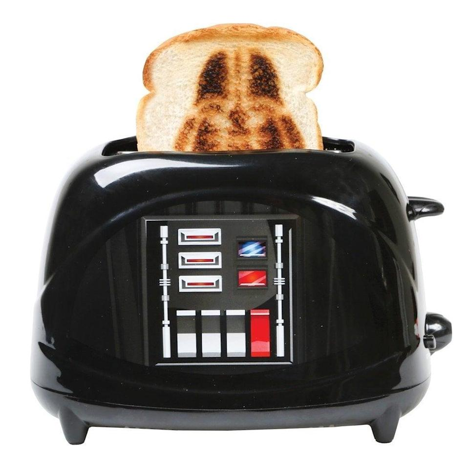 <p>Is he a Star Wars fan? He'll want to make toast every day with this <span>Star Wars Darth Vader Empire Toaster in Black</span> ($25).</p>