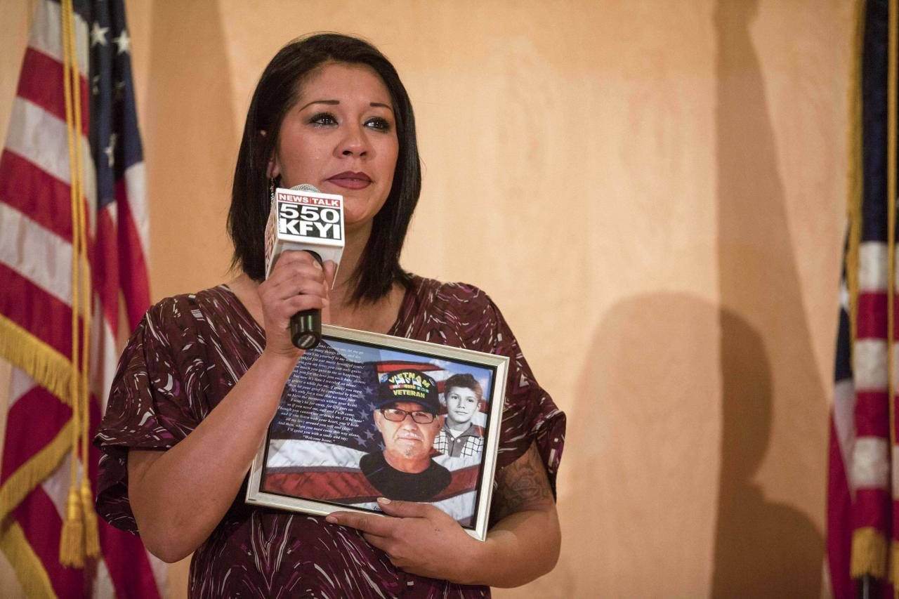 Pricella Valdez speaks about her Vietnam veteran father at a community forum over recent allegations of gross mismanagement and neglect of veterans health care in Phoenix, Arizona May 9, 2014. Veterans Administration Secretary Eric Shinseki rejected calls for his resignation following reports on whistleblowers' claims that up to 40 veterans died while waiting for appointments or specialist care at the VA hospital in Phoenix. REUTERS/Samantha Sais (UNITED STATES - Tags: MILITARY HEALTH POLITICS)