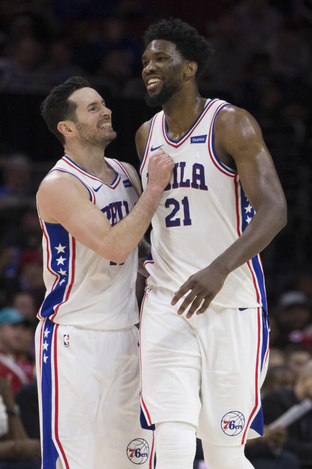 PHILADELPHIA, PA - FEBRUARY 24: JJ Redick #17 and Joel Embiid #21 of the Philadelphia 76ers react after a basket in the fourth quarter against the Orlando Magic at the Wells Fargo Center on February 24, 2018 in Philadelphia, Pennsylvania. The 76ers defeated the Magic 116-105. (Photo by Mitchell Leff/Getty Images)
