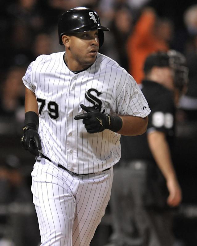 Chicago White Sox's Jose Abreu watches his solo home run during the seventh inning of a baseball game against the Arizona Diamondbacks in Chicago, Friday, May 9, 2014. (AP Photo/Paul Beaty)