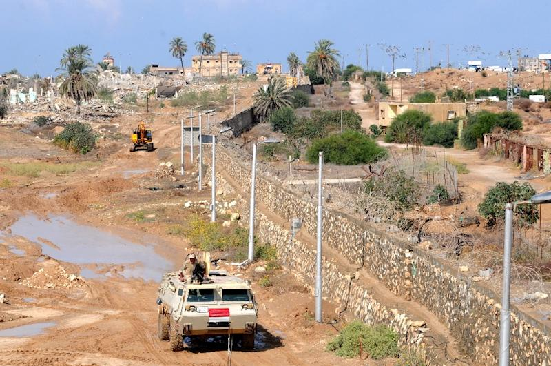 An Egyptian armoured vehicle patrols the Rafah border crossing with the Gaza Strip in 2014 (AFP Photo/Mohamed el-Sherbeny)