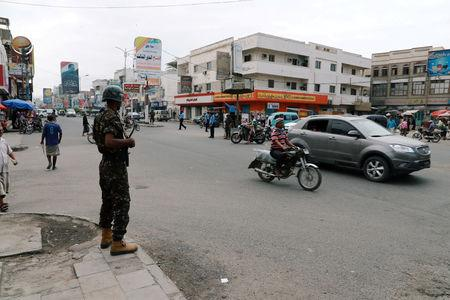 FILE PHOTO: A police trooper stands guard on a street in the Red Sea port city of Hodeidah, Yemen
